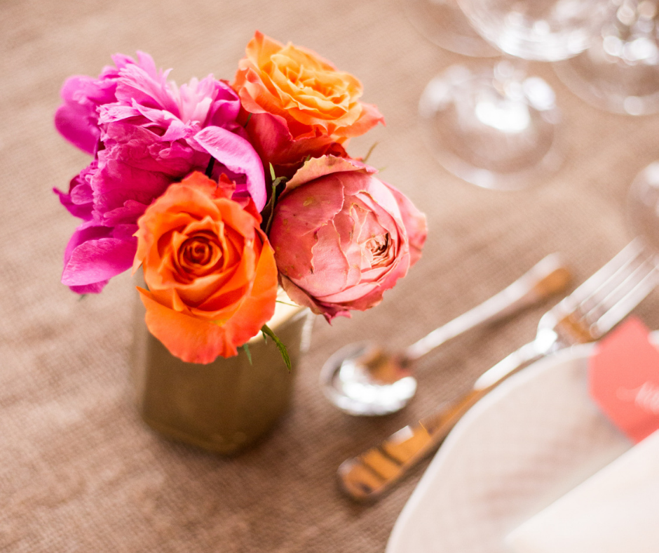featured image showing flowers in a diy bunch on a table for a wedding.